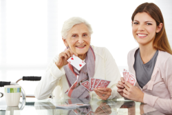 caregiver and patient playing cards